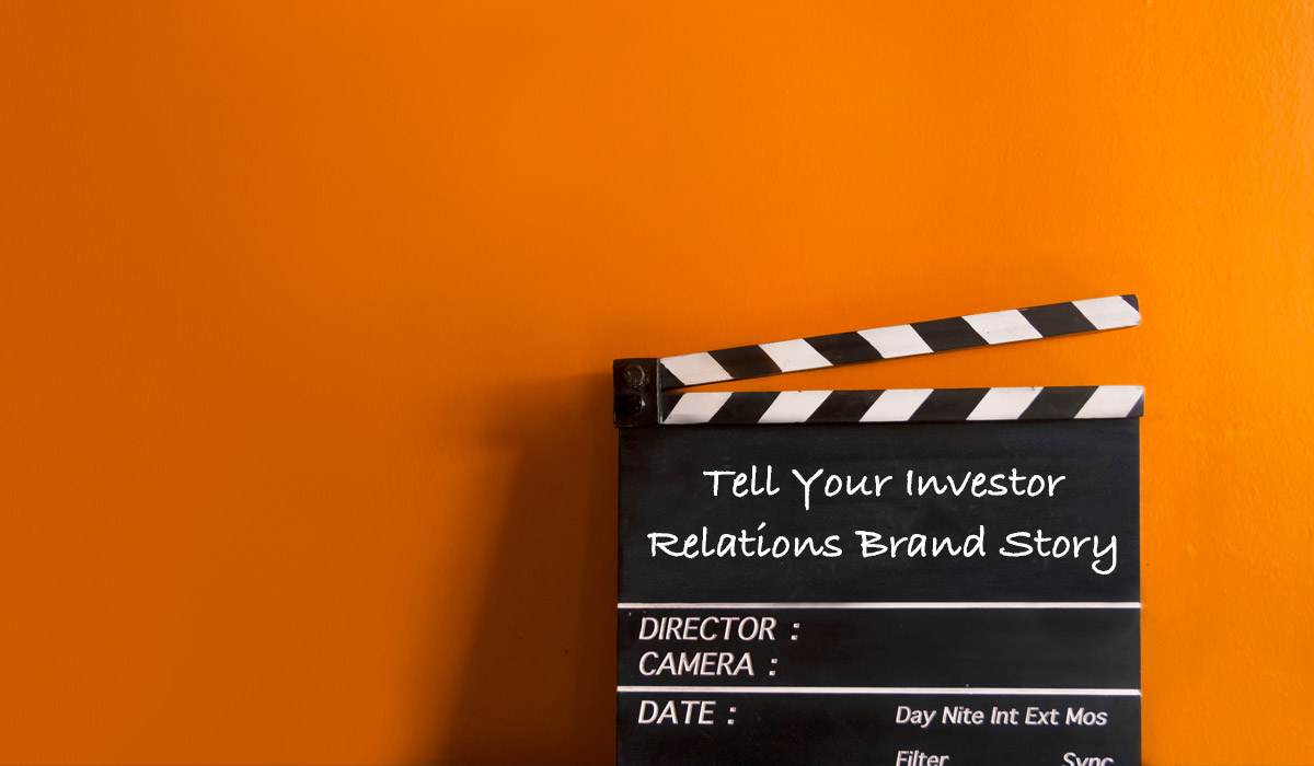 Tell Your Investor Relations Brand Story text on clapperboard on orange background