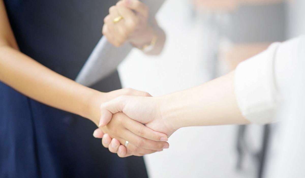 close up of businesswomen shaking hands