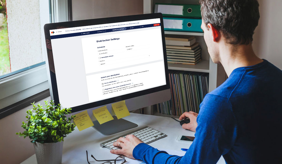 man using computer working on news direct platform