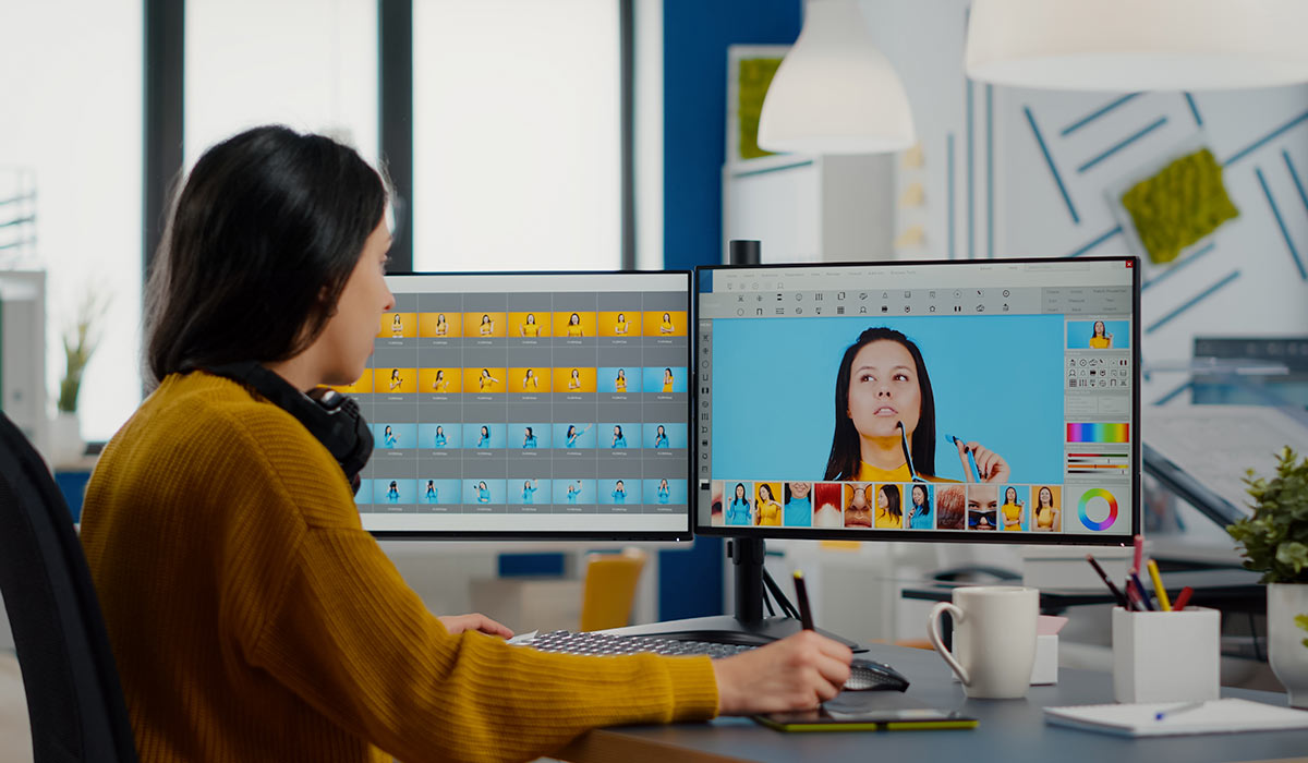 woman working on computer using video editing software