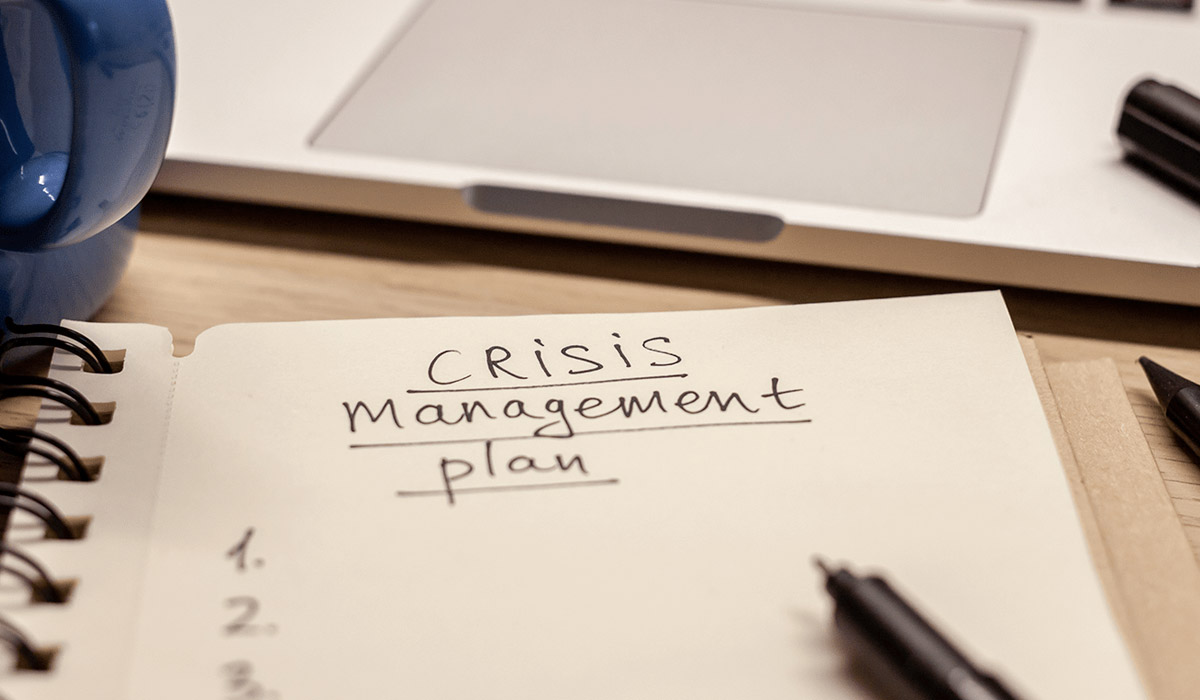 zoomed in notepad of text that says crisis management plan